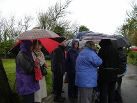 Gathering for the visit on a very wet afternoon at Steamer Point